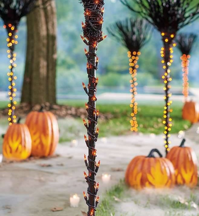 Awesome Halloween outdoor decoration with pumpkins and lights.