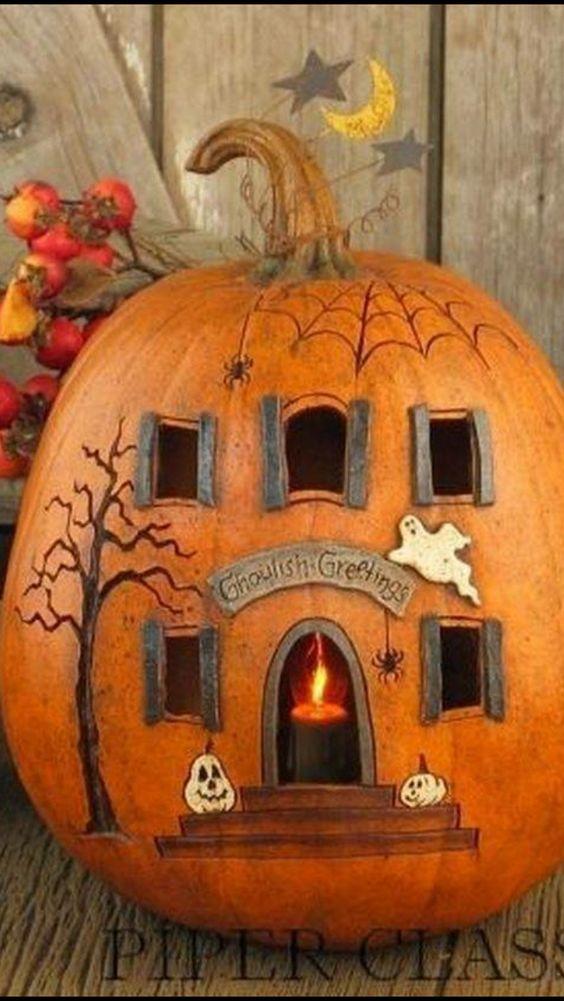 Awesome pumpkin house for Halloween decor.