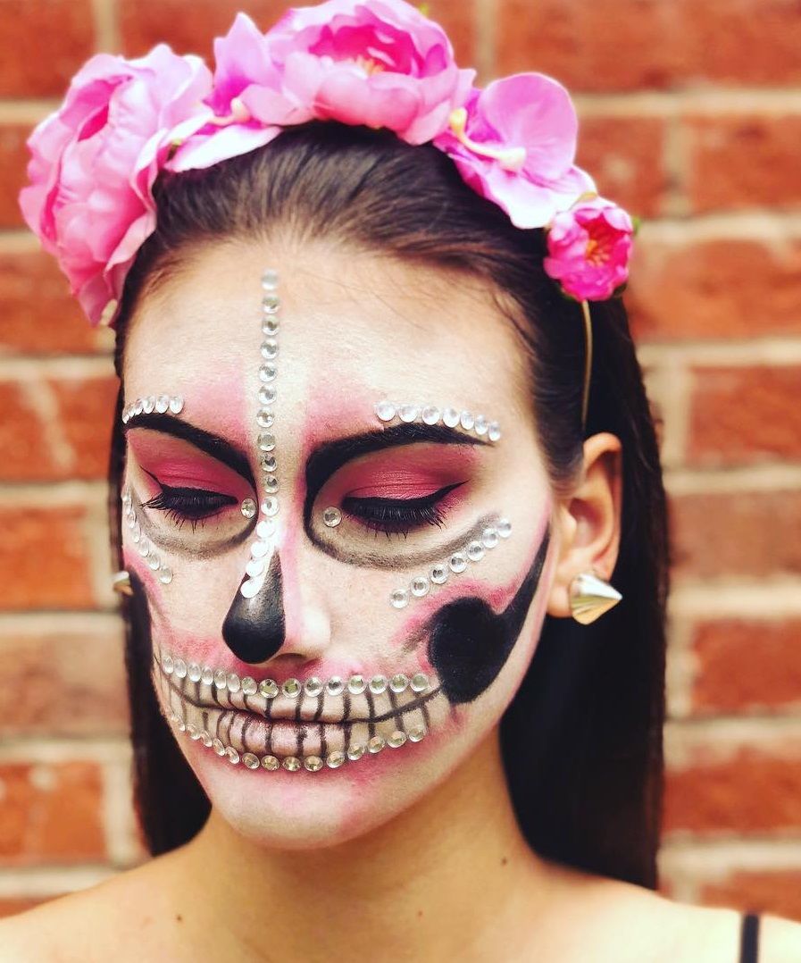 Beautiful skeleton makeup with flower hairband.