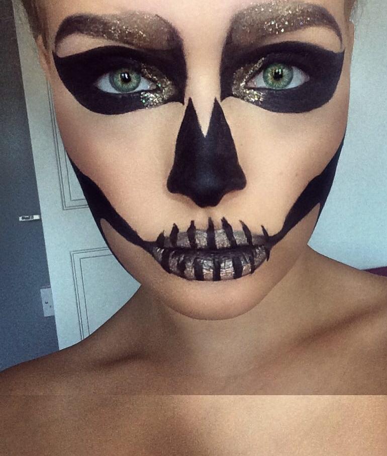 Black and gold glitter sugar skull makeup.