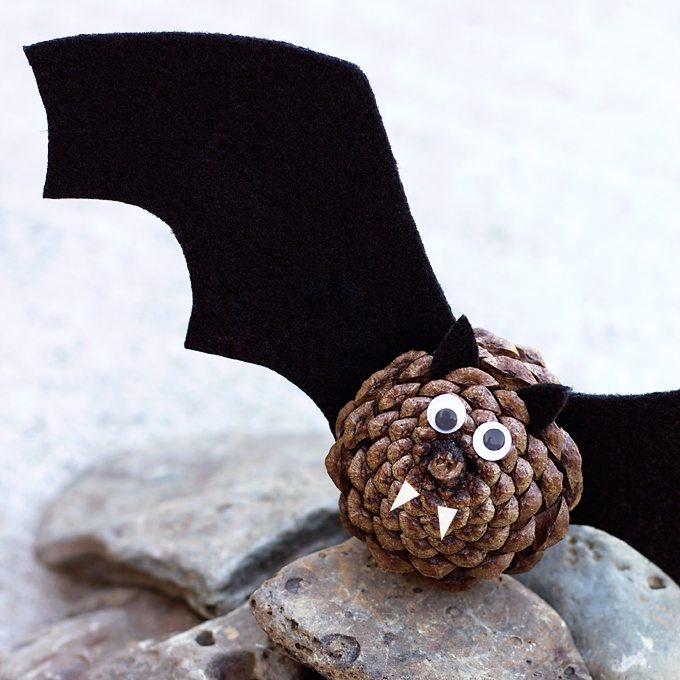 Black felt, pinecones, and wiggly eyes are all kids need to create a small colony of creepy-cute Pinecone Bats.