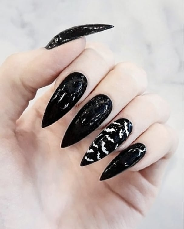 Black gel stiletto bat nails. Pic by xdemidoomx