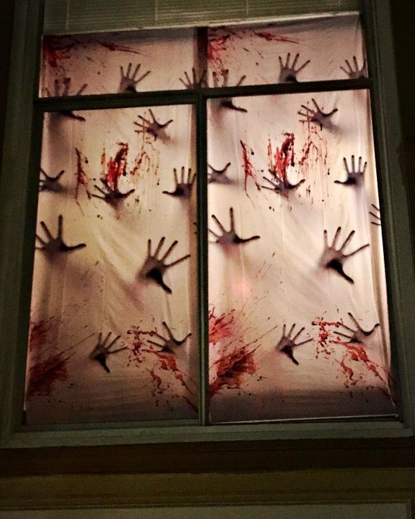 Bloody hands on window.