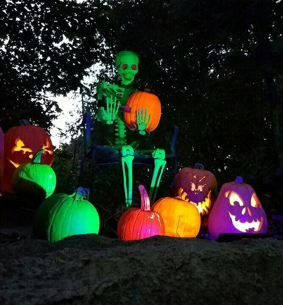 Colorful pumpkin and skeleton decor for outdoor.
