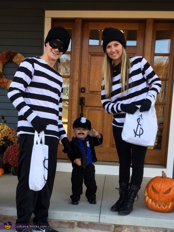 Cop n robbers family ready for halloween party.