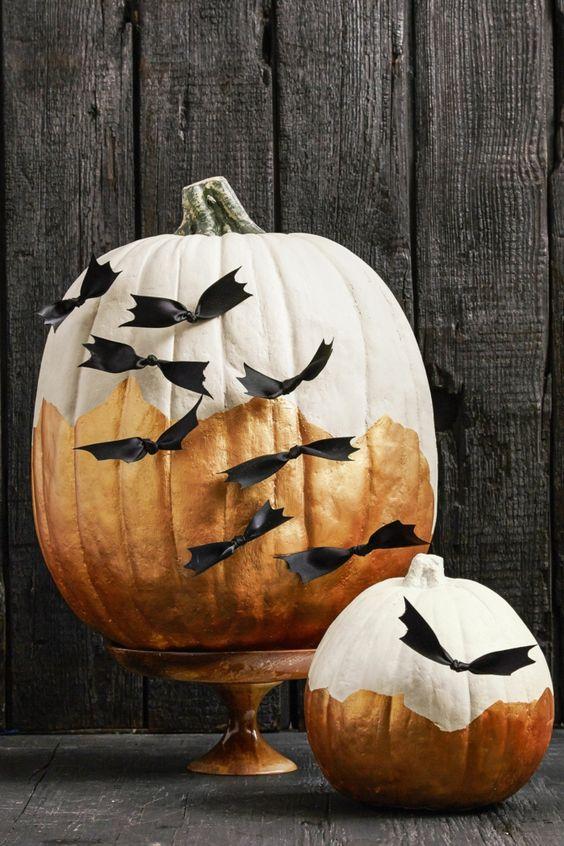 Craft bats on pumpkin.