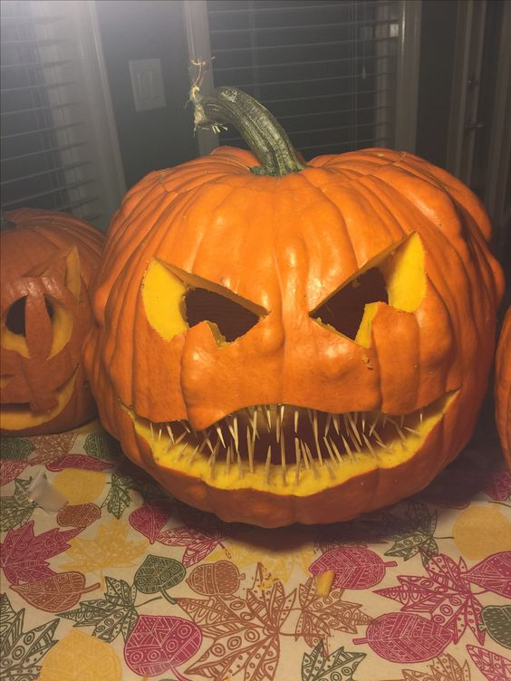 Creative pumpkin carving by toothpicks.