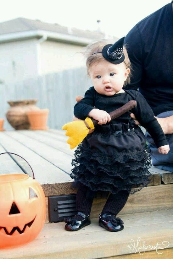 Cute and adorable witch costume with broom.