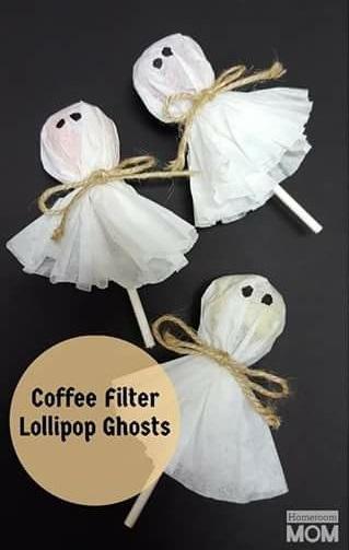 Cute ghost lollipops by coffee filters.