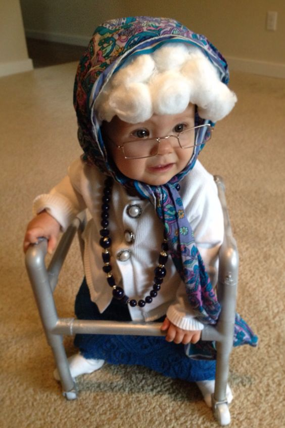Cute granny is ready for party by using wig, glasses and walker.