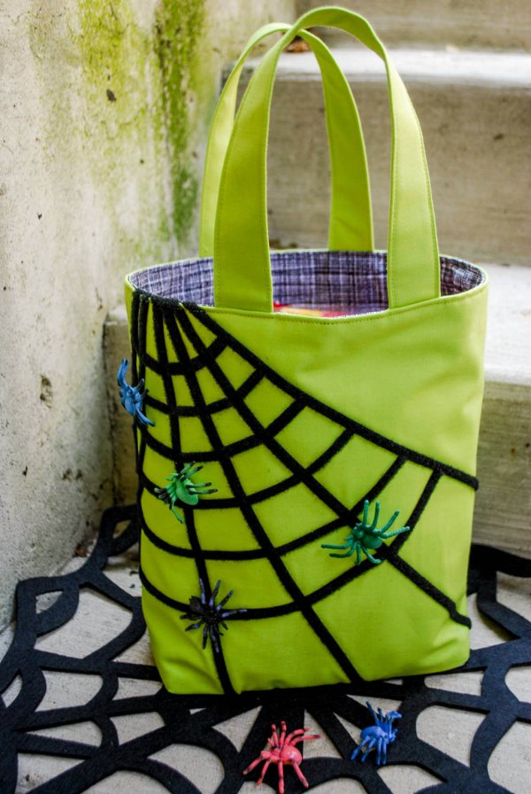 DIY trick or treat bag with sticky spiderwebs and moving spiders.