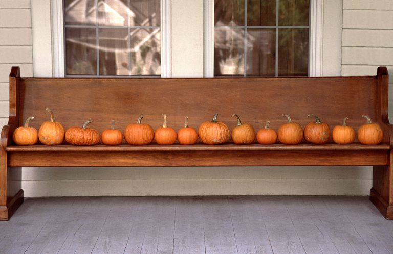 Easily decorated outdoor bench with pumpkins.