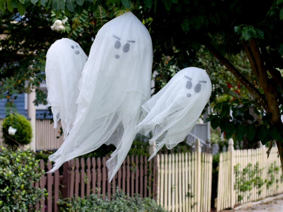 Front porch with free-flying ghosts made by inexpensively from balloons and gauze fabric.