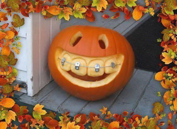 Funny pumpkin carving with braces.