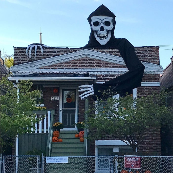 Giant skeleton on the top of house.
