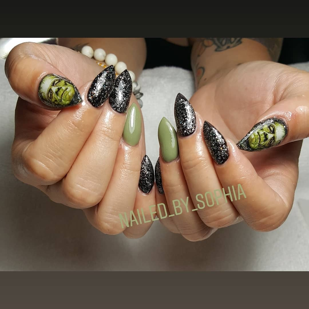Glitter black and green nails with ghost. Pic by nailed_by_sophia