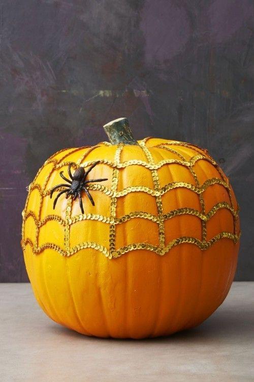 Golden web pumpkin with spider.