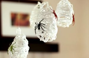 Gorgeous spiderweb with water balloons, white yarn, and craft glue.