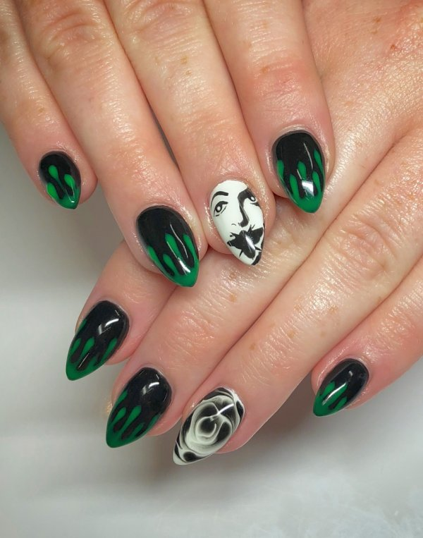 Green and black nails with scary face. Pic by persevere_nails