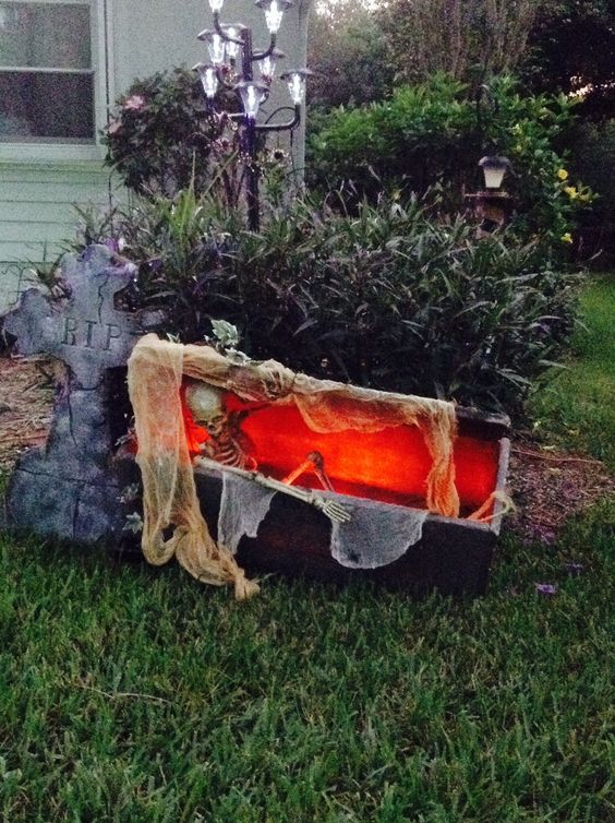Halloween coffin in outdoor red lighting adds the perfect touch.