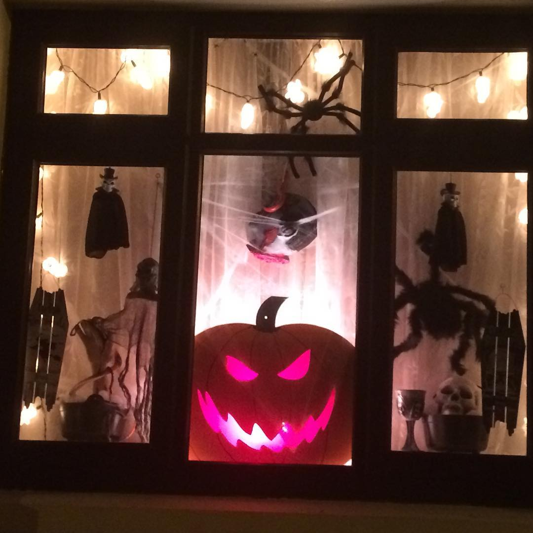 Handmade props for window decor at this Halloween.