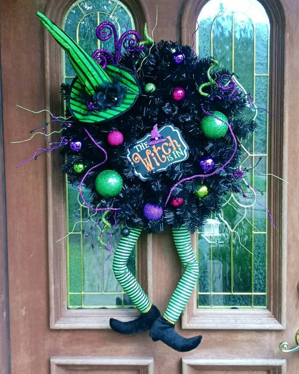 Handmade witch wreath with ornaments.