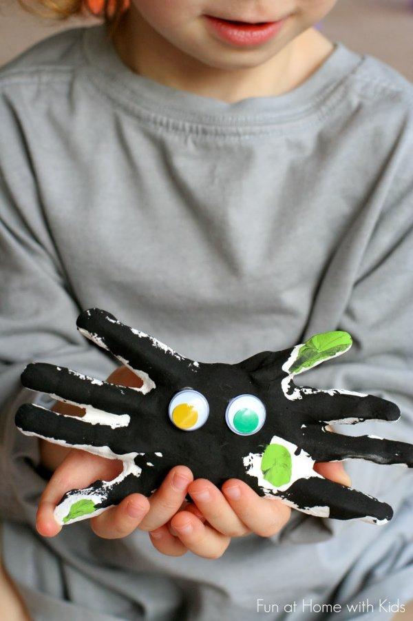 Handprint plaster spider craft.