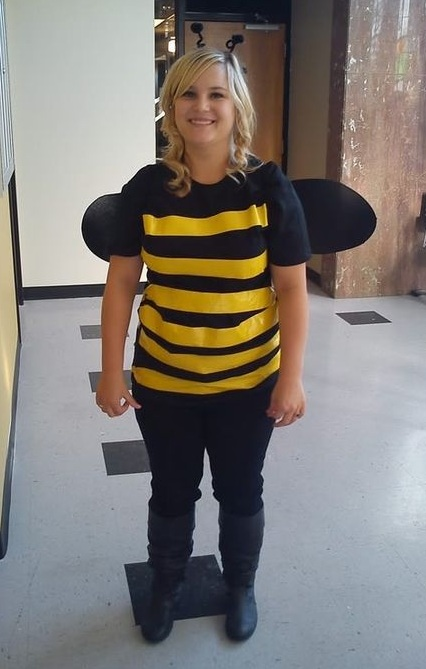 Honey bee outfit made by Yellow stripes with tape on black t-shirt and fabic wings.