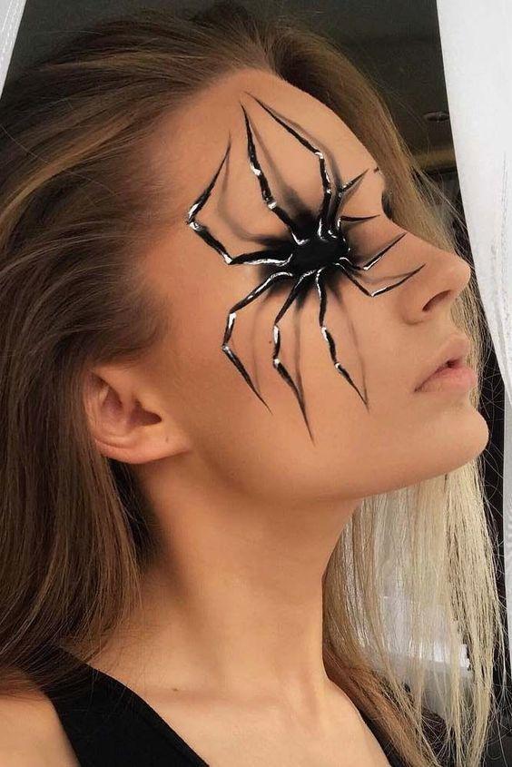 Impressive Halloween makeup with spider.