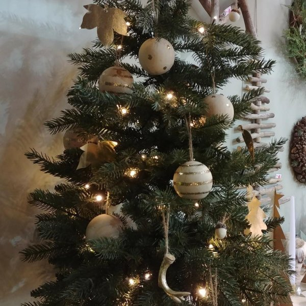 Lavish Christmas tree decor with stylish hanging balls made using natural timber with gold spots or stripes or plain. Pic by sw_sales