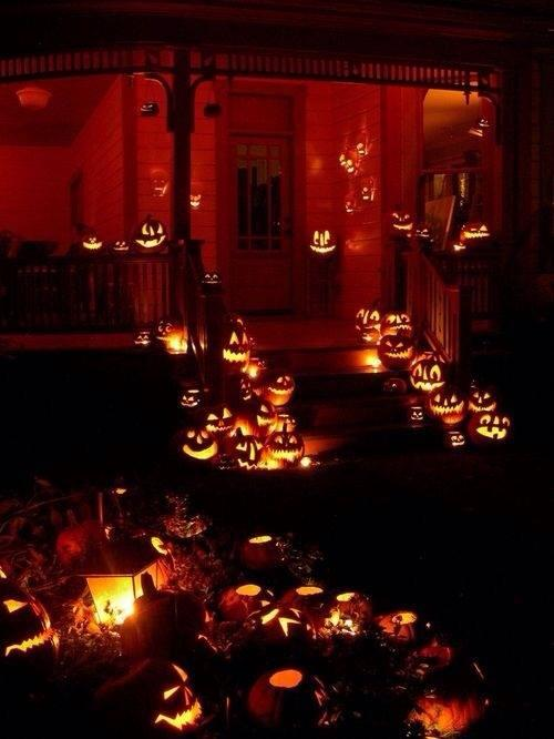 Lit up pumpkins at Halloween night for outdoor decoration.