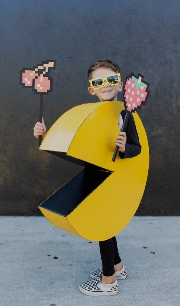 Lovely poke man costume with little pixelated accessories.