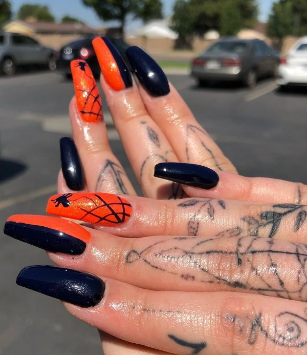 Orange and black spider web nails. Pic by iambeeboriboun
