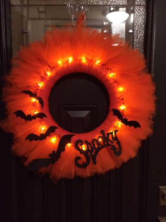 Orange tulle Halloween wreath with bats and lights.