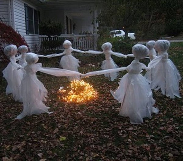 Playing ghosts in yard for Halloween party decoration idea.