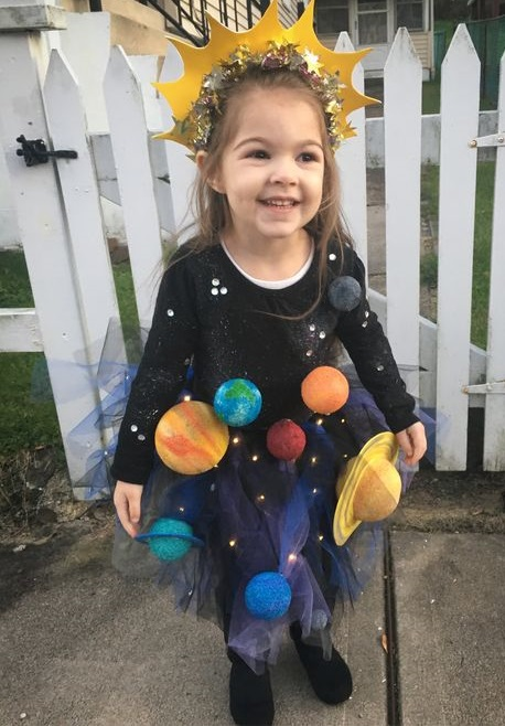 Pretty Solar system Halloween costume with 3D planets and lights.