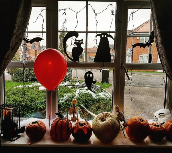 Pumpkin and paper craft for window decor.