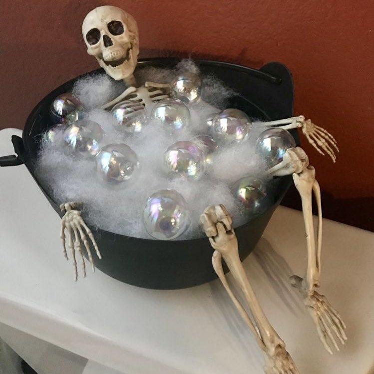 Relaxing skeleton in bubble bowl.