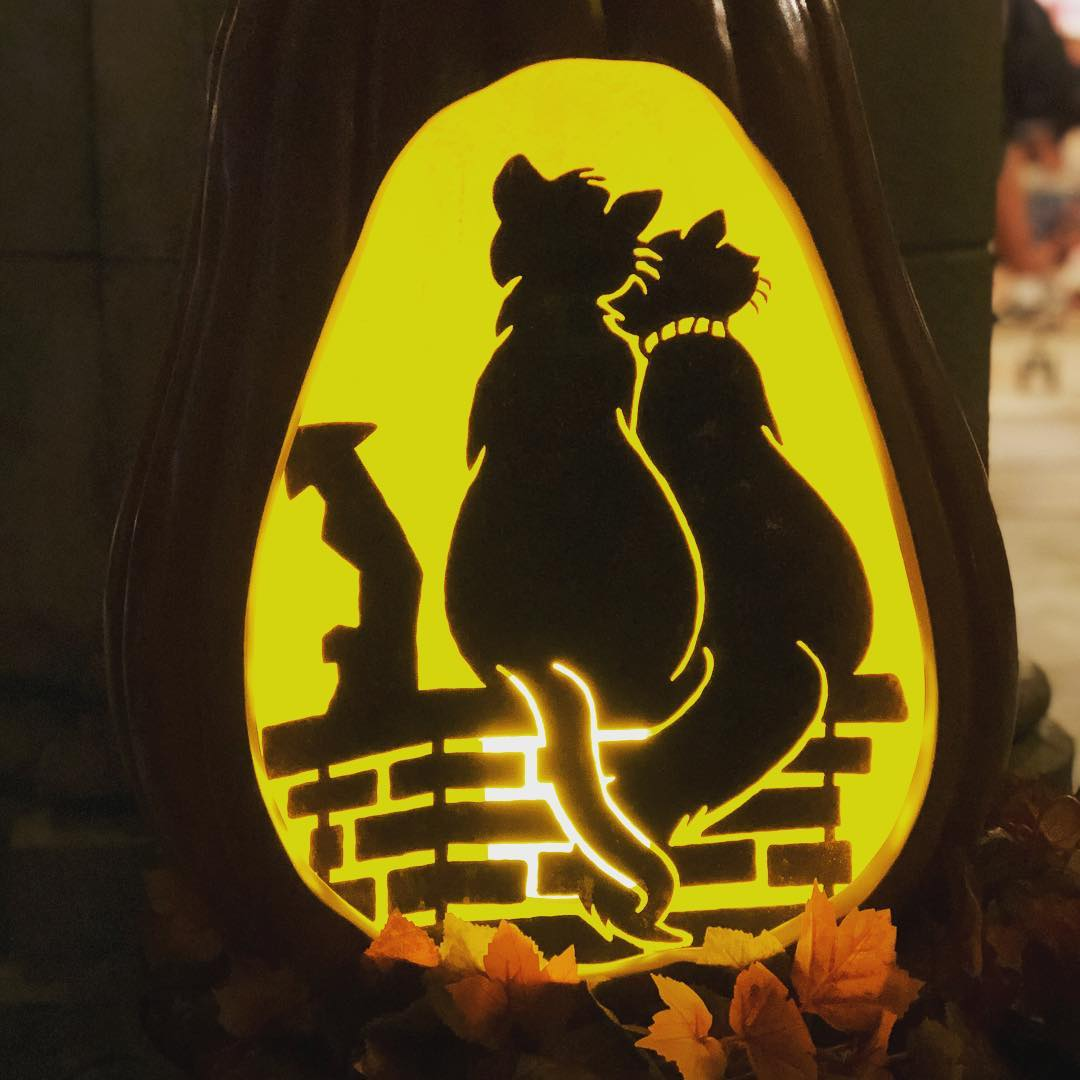 Romantic cat couple pumpkin carving idea.