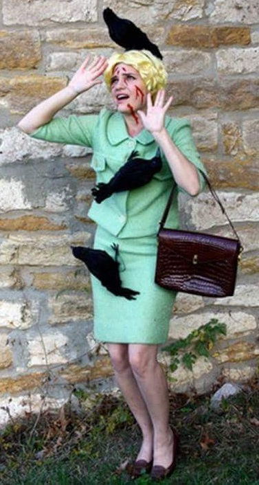 Soft toys crow on green dress Halloween costume.