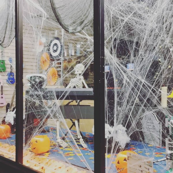 Spider web decor with skeleton and pumpkins.
