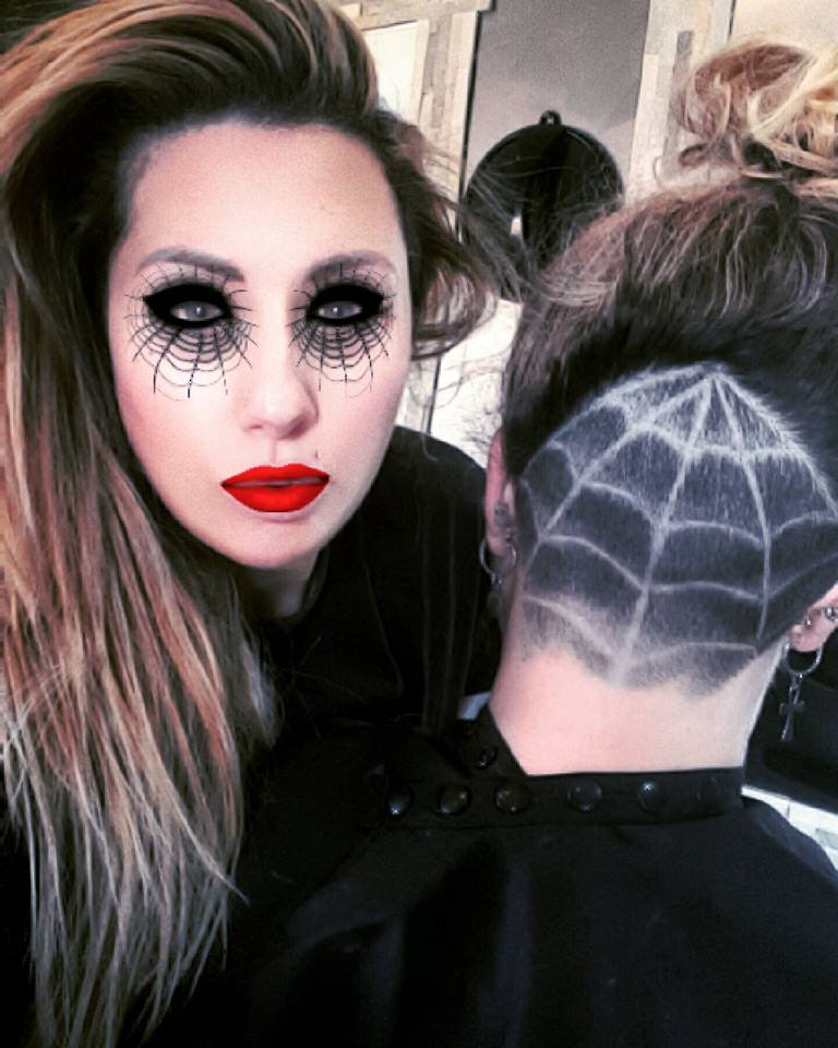 Spider web eye makeup with matching haircut.