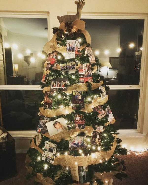 Traditional Christmas tree decorated with burlap, photos and lights. Pic by therealhousewifeoftomball