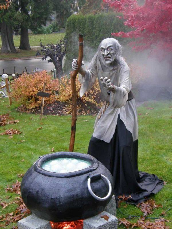 Unforgattable the bubbling witch cauldron scary Halloween outdoor decoration.
