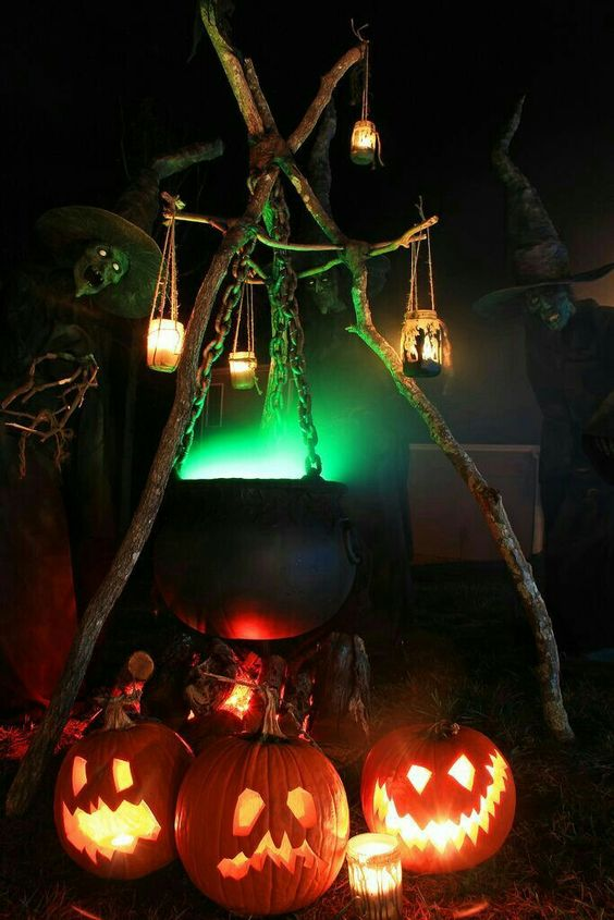 Witches cauldron and pumpkins haunted house display.