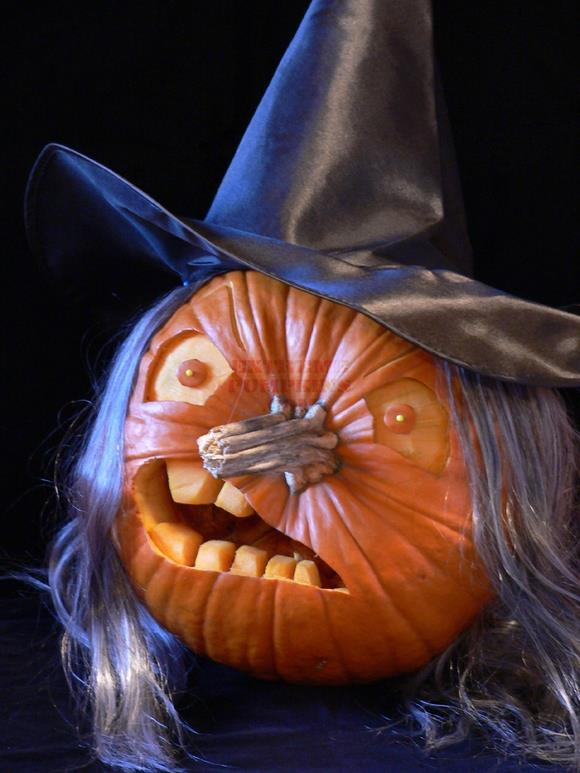 Wonderful witch pumpkin carving idea with hat and hairs.