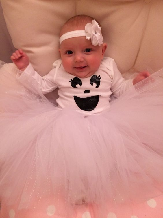 Wow tulle skirt and onesie with puffy paint ghost face for Halloween.