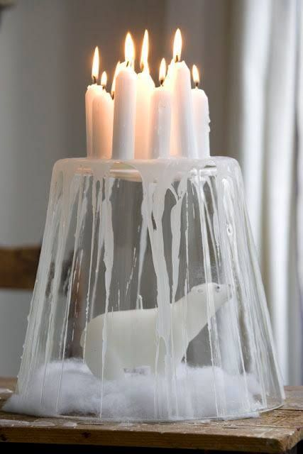 A bunch of candles on upside down glass.