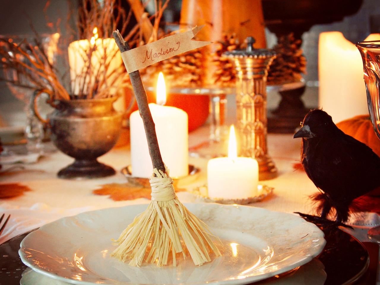 Addition of witch broom nameplates looks great with crow and candles for spooky Halloween table setting.