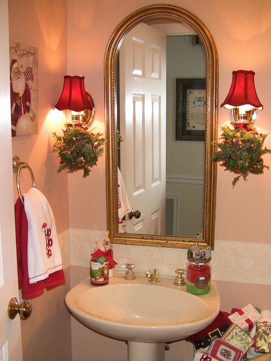 Adorable Christmas bathroom decoration with red lamp shade.